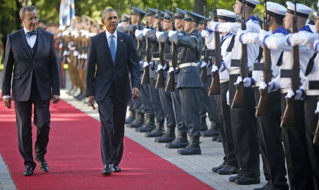 U.S. President Barack Obama and with Estonian President Toomas Hendrik Ilves review the honor guard at Kadriorg Palace in Tallinn, Estonia, Wednesday, Sept. 3, 2014. Obama is in Estonia for a one day visit where he will meet with Baltic State leaders before heading to the NATO Summit in Wales. (AP Photo/Charles Dharapak)