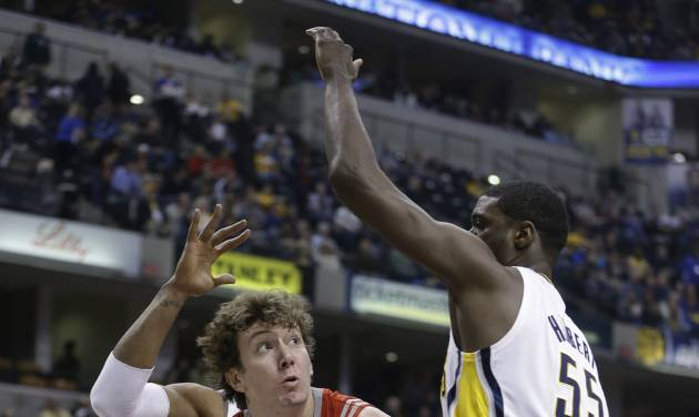 Houston Rockets' Omer Asik (3) puts up a shot against Indiana Pacers' Roy Hibbert, right, during the first half of an NBA basketball game Friday, Jan. 18, 2013, in Indianapolis. (AP Photo/Darron Cummings)