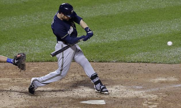 Milwaukee Brewers' Jonathan Lucroy hits a two-run home run during the thirteenth inning of a baseball game against the New York Mets, Thursday, June 12, 2014, in New York. (AP Photo/Frank Franklin II)