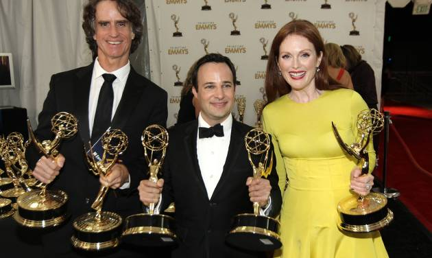 """From left, Director Jay Roach, writer Danny Strong, and Actress Julianne Moore, pose backstage with the awards they won for the HBO movie """"Game Change,"""" at the 64th Primetime Emmy Awards at the Nokia Theatre on Sunday, Sept. 23, 2012, in Los Angeles. (Photo by Matt Sayles/Invision/AP)"""