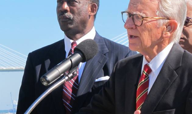 Wilbur Johnson, left, the chairman of the board of the International African American Museum, listens as Charleston Mayor Joseph P. Riley Jr., announces updated plans for the museum during a news conference on the waterfront in Charleston, S.C., on Wednesday, Oct. 23, 2013. Riley said the $75 million museum will be financed with a combination of city, county and state funds as well as private donations. Construction is expected to begin in about two years. (AP Photo/Bruce Smith)