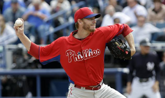 Philadelphia Phillies pitcher Roy Halladay delivers in the first inning to the New York Yankees during a spring training baseball game Friday, March 1, 2013, in Tampa, Fla. (AP Photo/Chris O'Meara)