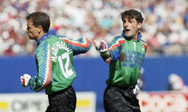 FILE - In this Thursday, June 23, 1994 file photo, Italy's goalkeeper Gianluca Pagliuca, right, passes substitute keeper Luca Marchegiani, left, as Pagliuca leaves the field of play after receiving a red card during the World Cup Group E opening round soccer match against Norway, at Giants Stadium in East Rutherford, N.J. On this day: Italy's Pagliuca becomes the first goalkeeper to be sent off in a World Cup finals match. Italy still prevailed 1-0. (AP Photo/Gianni Foggia, File)