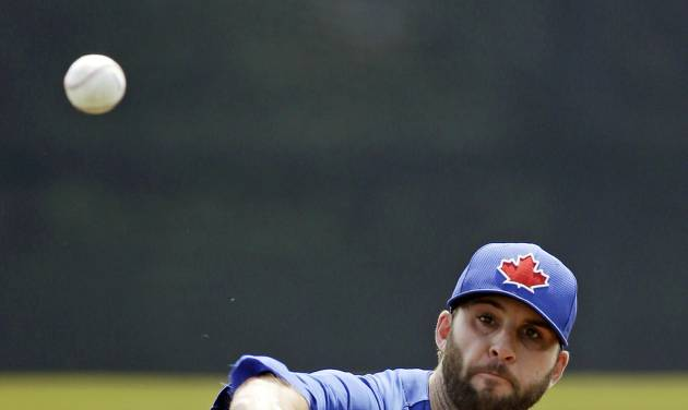 Toronto Blue Jays starting pitcher Brandon Morrow warms up during a spring training exhibition baseball game against the Atlanta Braves in Dunedin, Fla., Saturday, March 23, 2013. (AP Photo/Kathy Willens)