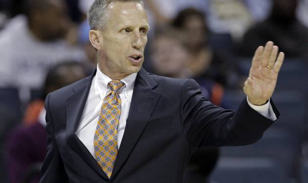 Charlotte Bobcats coach Mike Dunlap signals to his team against the Indiana Pacers during the first half of an NBA basketball game in Charlotte, N.C., Friday, Nov. 2, 2012. The Bocats won 90-89. (AP Photo/Chuck Burton)