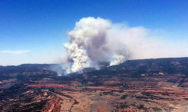 This image provided by Inci Web shows a plume of smoke in the Chuska Mountains near Naschitti, N.M. on Sunday, June 15, 2014.  Residents of a Navajo community near the New Mexico-Arizona border prepared for evacuations Monday as strong winds fanned the flames of a wildfire burning in the Chuska Mountains.  Fire officials were conducting reconnaissance missions to get a better handle on the fire's size, but Navajo Nation officials said more than 3 square miles have been charred since the fire was first reported Friday. (AP Photo/Inciweb)