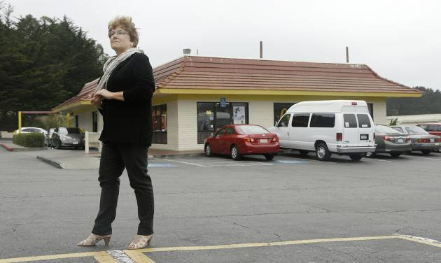 Kathryn Slater-Carter poses for photographs at a McDonald's restaurant she owns in Daly City, Calif., Tuesday, Sept. 2, 2014. Slater-Carter spearheaded a bill in California that could soon give franchisees greater protections in their dealings with franchisers. Around the country, union organizers are pushing to make McDonald's take responsibility for how workers are treated at its franchised restaurants.  (AP Photo/Jeff Chiu)