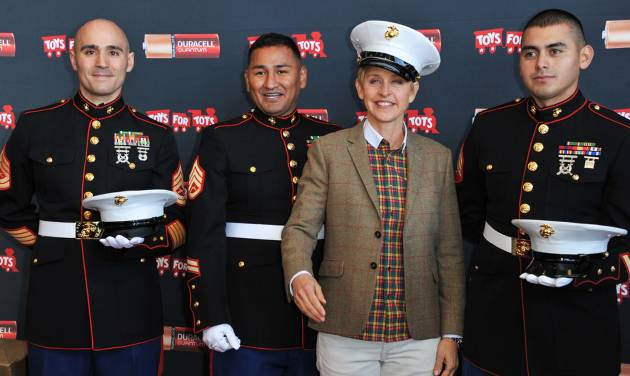 """From left, Gunnery Sergeant Phillip Campo, Staff Sergeant Victor Pozo, Ellen DeGeneres, Sergeant Antonio Sanchezattend the Ellen DeGeneres officially launches the Duracell """"Power a Smile"""" Program, on Friday, Nov.  22, 2013, at Van Nuys Airport in Los Angeles. (Photo by Richard Shotwell/Invision/AP)"""