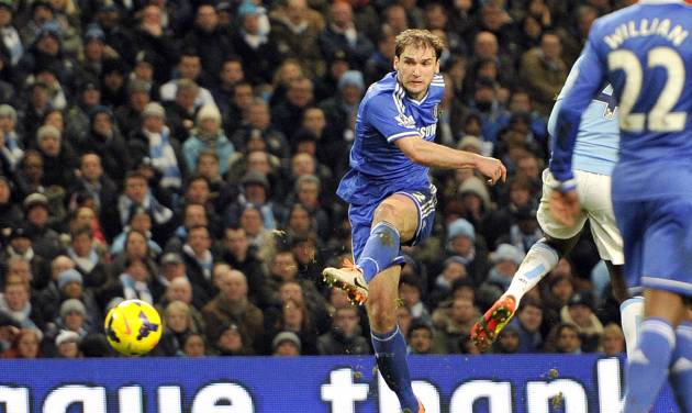 Chelsea's Branislav Ivanovic scores the first goal of the game for his side during their English Premier League soccer match against Manchester City at the Etihad stadium in Manchester, England, Monday Feb. 3, 2014. (AP Photo/Clint Hughes)