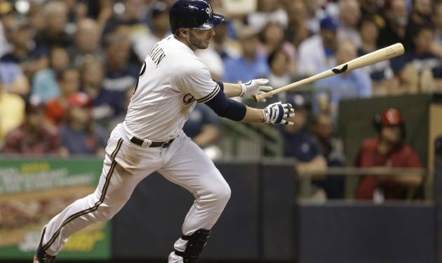 Milwaukee Brewers' Ryan Braun watches his two-run single against the Washington Nationals during the fifth inning of a baseball game Tuesday, June 24, 2014, in Milwaukee. (AP Photo/Jeffrey Phelps)