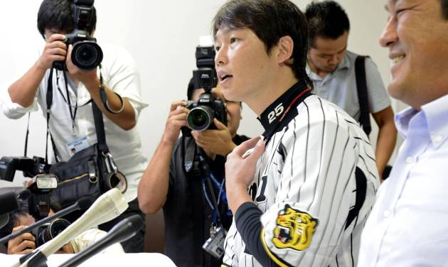 The Japan Professional Baseball Players Association Chairman Takahiro Arai speaks during a news conference in Nishinomiya, Japan, Tuesday, Sept. 4, 2012. The association agreed to take part in the 2013 World Baseball Classic Tuesday, backing off from a threat to boycott the event over the way tournament revenue is shared. (AP Photo/Kyodo News) JAPAN OUT, MANDATORY CREDIT, NO LICENSING IN CHINA, HONG KONG, JAPAN, SOUTH KOREA AND FRANCE