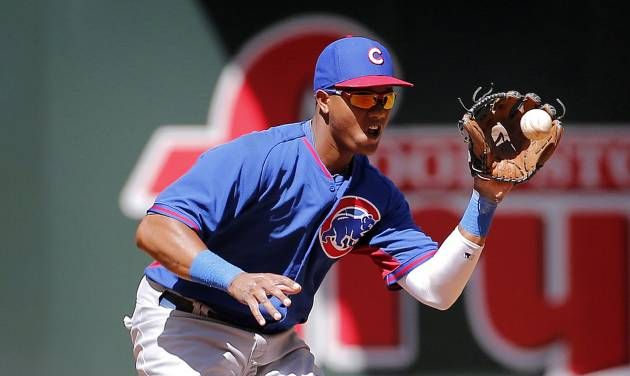 Chicago Cubs' Starlin Castro fields a ground out hit by Arizona Diamondbacks' Eric Chavez during the second inning of an exhibition spring training baseball game, Saturday, March 29, 2014, in Phoenix. (AP Photo/Matt York)