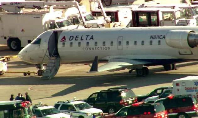 This photo from video provided by WLS-TV in Chicago shows fire and ambulance crews on the runway at Midway Airport after reports of a medical emergency that led to the quarantine of a Delta airplane Thursday, April 26, 2012, in Chicago. (AP Photo/WLS-TV) TELEVISION OUT