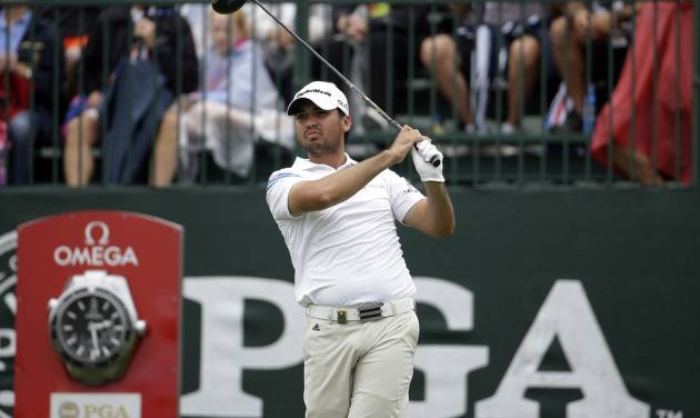 Jason Day, of Australia, watches his tee shot on the first hole during the second round of the PGA Championship golf tournament at Valhalla Golf Club on Friday, Aug. 8, 2014, in Louisville, Ky. (AP Photo/Jeff Roberson)