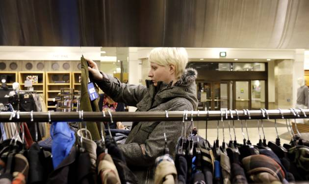 FILE - In this Thursday, Jan. 10, 2013 file photo, a woman shops at a Nordstrom store in Chicago.  U.S. consumer prices were flat last month, the latest sign inflation is in check. That could give the Federal Reserve room to continue its efforts to stimulate growth.  The consumer price index has risen 1.6 percent in the 12 months ending in January, the Labor Department said Thursday, Feb. 21, 2013. That's down from a 2.9 percent pace a year ago.  (AP Photo/Nam Y. Huh, File)
