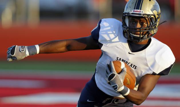 Southmoore's Jaelon Walker (3) looks for running room during a high school football game between Carl Albert and Southmoore in Midwest City, Okla., Friday, Aug. 31, 2012. Photo by Nate Billings, The Oklahoman