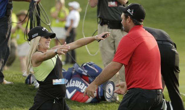 Patrick Reed, right, greets his wife Justine after winning the Humana Challenge golf tournament on the Palmer Private course at PGA West, Sunday, Jan. 19, 2014 in La Quinta, Calif. (AP Photo/Chris Carlson)