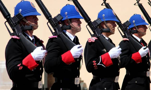 This May 13, 2013 photo shows the changing of the guard outside the Prince's Palace in Monaco at 11:55 a.m. each day. It's one of a number of free things to see and do in Monaco. (AP Photo/Michelle Locke)
