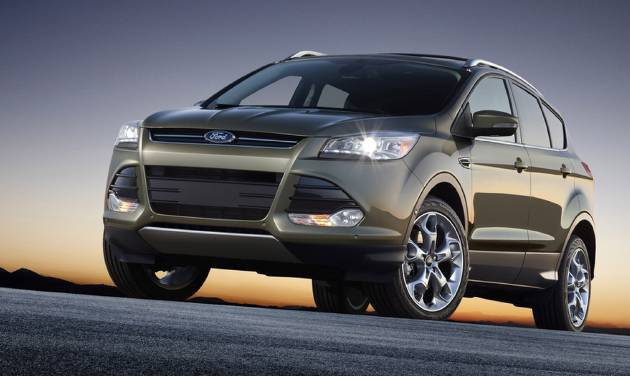 FILE - This undated file product image provided by the Ford Motor Co. shows the 2013 Ford Escape. Ford is recalling about 7,600 Escape SUVs to fix coolant leaks that can cause fires. The recall affects 2013 Escapes with 1.6-liter four-cylinder engine. (AP Photo/Ford Motor Co., File)