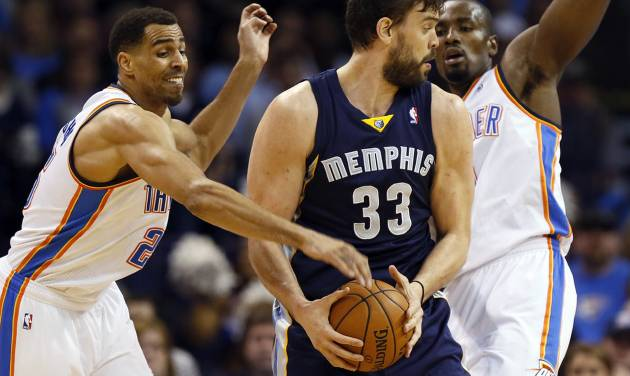 Oklahoma City's Thabo Sefolosha (25), left,  and Serge Ibaka (9) defend Memphis' Marc Gasol (33) during an NBA basketball game between the Memphis Grizzlies and the Oklahoma City Thunder at Chesapeake Energy Arena in Oklahoma City, Friday, Feb. 28, 2014. Photo by Nate Billings, The Oklahoman