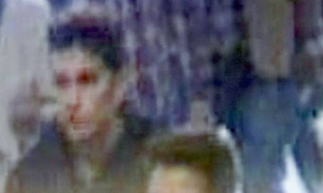 The image of two Iranian who Inetrpol say were traveling with stolen passports on a missing Malaysia Arlines jetliner displayed on a screen during a presser at the Interpol headquarters in Lyon, central France, Tuesday, March 11, 2014.  (AP Photo/Laurent Cipriani)