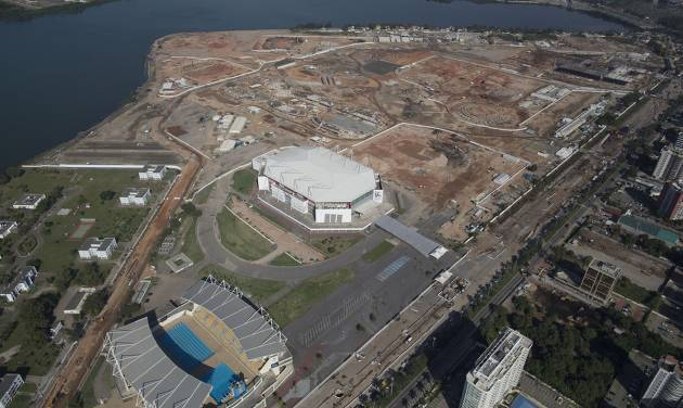 This June 27, 2014 aerial view photo shows Olympic Park under construction in an area previously occupied by the Jacarepagua Autodrome, and the nearby athlete village in Rio de Janeiro, Brazil. Brazil has just pulled off the World Cup. Now the tough work begins: preparing Rio de Janeiro's 2016 Olympics, which is an even larger challenge than football's big event. (AP Photo/Leo Correa)