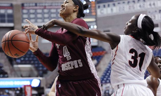 Georgia's Erika Ford, right, fouls Saint Joseph's Natasha Cloud, left, during the first half of a first-round game of the NCAA women's college basketball tournament, Sunday, March 23, 2014, in Storrs, Conn. (AP Photo/Jessica Hill)