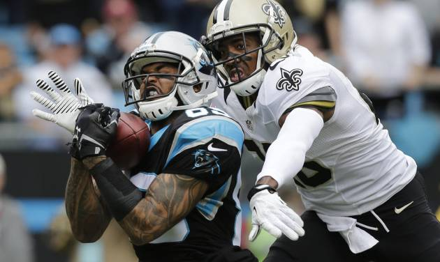 FILE - In this Dec. 22, 2013, file photo, Carolina Panthers' Steve Smith, left, catches a pass as New Orleans Saints' Keenan Lewis, right, defends in the first half of an NFL football game in Charlotte, N.C. The Panthers released their all-time leading receiver on Thursday, March 13, 2014, after 13 seasons.  (AP Photo/Chuck Burton, File)