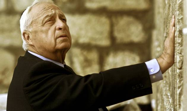 "FILE - In this Wednesday Feb. 7, 2001 file photo, Ariel Sharon, then Israel's Prime Minister-elect, looks up as he touches Judaism holiest site, the Western Wall, in Jerusalem. The son of former Israeli Prime Minister Ariel Sharon says his father has died on Saturday, Jan. 11, 2014. The 85-year-old Sharon had been in a coma since a debilitating stroke eight years ago.  His son Gilad Sharon said: ""He has gone. He went when he decided to go."" (AP Photo/David Guttenfelder, File)"