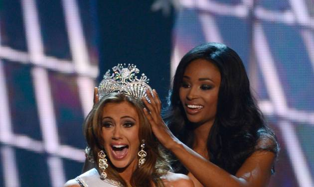 FILE - In this Sunday, June 16, 2013 file photo, Miss Connecticut Erin Brady is crowned the winner of the Miss USA 2013 pageant by Nana Meriwether in Las Vegas. Brady, of South Glastonbury, Connecticut, relinquishes her crown Sunday June 8, 2014 when the 2014 pageant competition being held in Baton Rouge selects a new Miss USA. (AP Photo/Jeff Bottari, File)