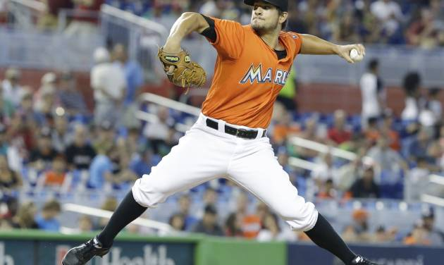 Miami Marlins' Brad Hand delivers a pitch during the first inning of a baseball game against the San Francisco Giants, Sunday, July 20, 2014 in Miami. (AP Photo/Wilfredo Lee)