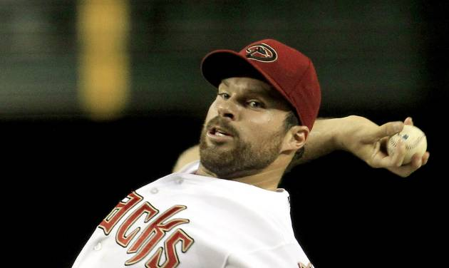 Arizona Diamondbacks' Josh Collmenter throws against the Chicago Cubs during the fourth inning in a baseball game on Friday, June 22, 2012, in Phoenix.(AP Photo/Ross D. Franklin)