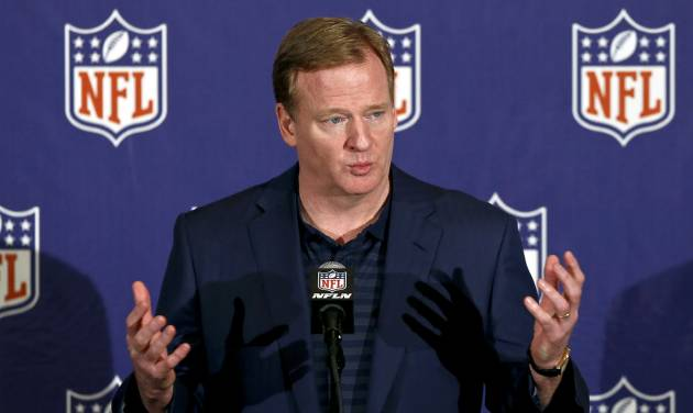 """FILE - In this March 20, 2013 file photo, NFL Commissioner Roger Goodell answers a reporter's question during a news conference during the annual NFL football meetings in Phoenix. The NFL has ordered all teams to have cameras in their locker rooms next season, with video shown only on stadium scoreboards. It's part of Goodell's initiative for """"enhancing the fan experience in our stadiums. (AP Photo/Ross D. Franklin, File)"""