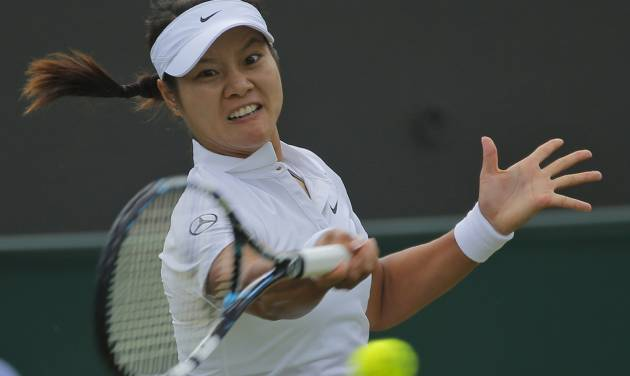 Li Na of China plays a return to Yvonne Meusburger of Austria during their women's singles match at the All England Lawn Tennis Championships in Wimbledon, London,  Wednesday, June 25, 2014. (AP Photo/Pavel Golovkin)