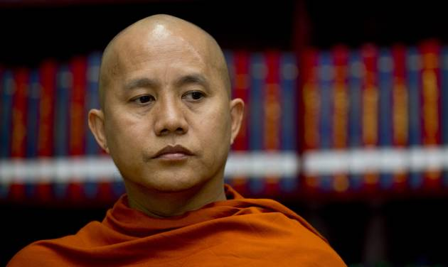 """Buddhist monk Wirathu sits in the library of the Ma Soe Yein monastery during an interview in Mandalay, Myanmar on March 27, 2013. The popular monk insists he is a man of peace, but has emerged as the spiritual leader of a pro-Buddhist fringe movement accused of fueling a bloody campaign of sectarian violence. Wirathu insists the world has misunderstood him. """"If they knew my true ideas, they would call me savior,"""" he says. (AP Photo/Gemunu Amarasinghe)"""