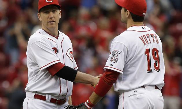 Cincinnati Reds' Joey Votto (19) congratulates Todd Frazier after they defeated the Chicago Cubs 5-2 in a baseball game on Saturday, May 25, 2013, in Cincinnati. Frazier had two RBIs in the game. (AP Photo/Al Behrman)