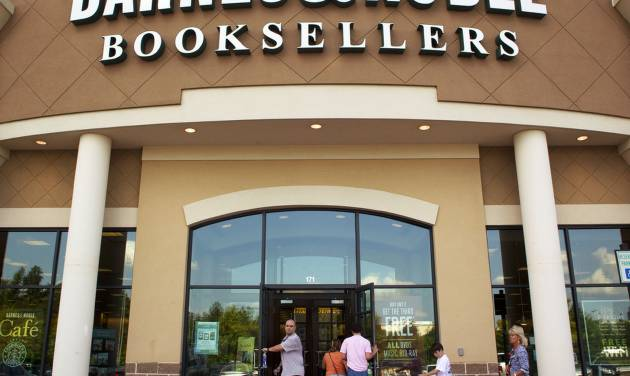 """FILE-In this Monday, June 18, 2012, file photo customers enter the Barnes and Noble Booksellers store in Hoover, Ala. Barnes & Noble says its fiscal first-quarter loss narrowed, lifted by sales of e-books and other digital content as well as sales of the """"Fifty Shades of Grey"""" series at its bookstores. (AP Photo/Dave Martin)"""