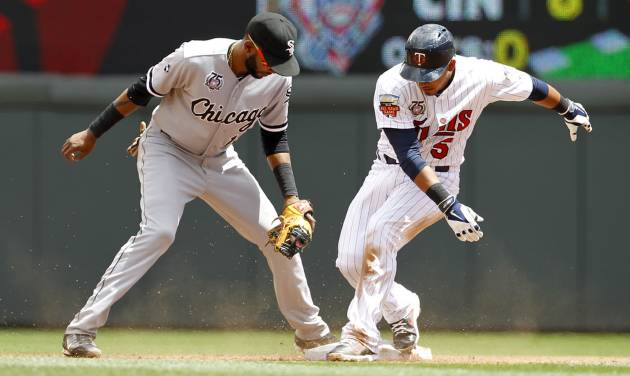 Minnesota Twins'  Eduardo Escobar, right, makes it safely to second base on a double to right as Chicago White Sox shortstop Alexei Ramirez gets the late throw during the third inning of a baseball game in Minneapolis, Sunday, July 27, 2014. (AP Photo/Ann Heisenfelt)