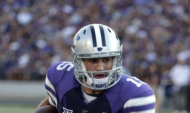 Kansas State quarterback Jake Waters (15) runs into the end zone to score a touchdown during the first half of an NCAA college football game against Stephen F. Austin Saturday, Aug. 30, 2014, in Manhattan, Kan. (AP Photo/Charlie Riedel)