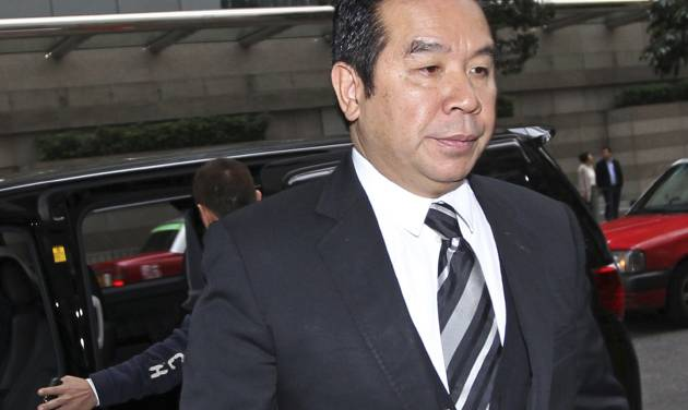 Hong Kong businessman Carson Yeung, also owner of Birmingham City football club, arrives for the verdict in his money laundering trial at Hong Kong District Court Monday, March 3, 2014. Yeung was found guilty of money laundering by the Hong Kong District Court and was convicted over charges relating to his handling of 721 million Hong Kong dollars ($93 million) using five bank accounts between January 2001 and December 2007. (AP Photo)