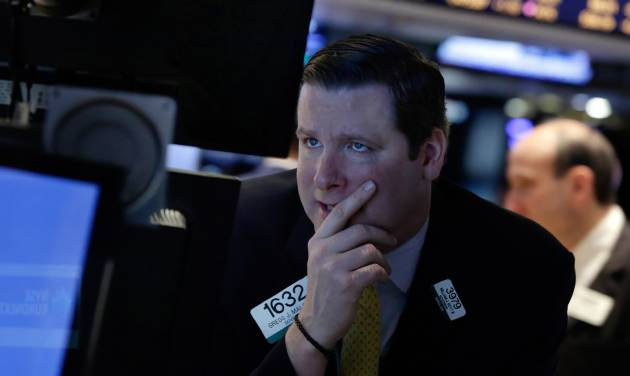 Specialist Gregg Maloney works on the floor of the New York Stock Exchange, Monday, March 3, 2014. Global stock markets are down sharply on tensions over Russia's military advance into Ukraine and the threat of sanctions by Western governments. (AP Photo/Richard Drew)