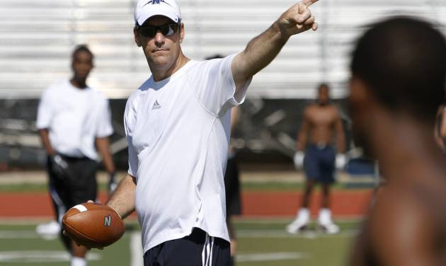 Edmond North football coach Scott Burger instructs players during a skills camp in Edmond, Wednesday June 12, 2013. Photo By Steve Gooch, The Oklahoman  Steve Gooch - The Oklahoman
