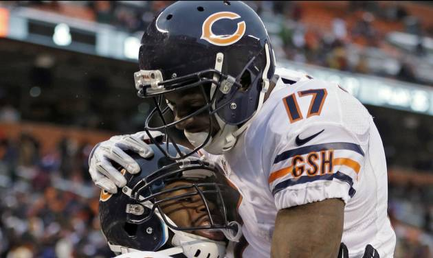Chicago Bears running back Michael Bush (29) celebrates with wide receiver Alshon Jeffery (17) after Bush ran 40 yards for a touchdown against the Cleveland Browns in the fourth quarter of an NFL football game Sunday, Dec. 15, 2013, in Cleveland. The Bears won 38-31. (AP Photo/Tony Dejak)