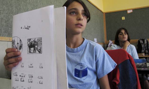 In a Wednesday, May 2, 2012 photo, schoolgirls study Aramaic in the Arab village of Jish, northern Israel. Jish is one of two villages in the Holy Land's tiny Christian community that are teaching Aramaic to their children in an ambitious effort to preserve the language that Jesus spoke, centuries after it all but disappeared from the modern Middle East. (AP Photo/Diaa Hadid)