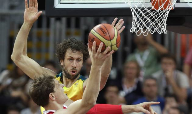Australia's Matt Nielsen reaches to block as Russia's Timofey Mozgov drives to the basket during a men's basketball game at the 2012 Summer Olympics, Monday, Aug. 6, 2012, in London. (AP Photo/Charles Krupa)