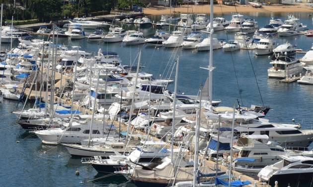 In this Tuesday,  Jan. 7, 2014 photo, yachts are docked at a marina in the Bay of Acapulco, Mexico. After inspecting more than 1,600 vessels in late November, the Mexican government's Treasury Department announced it had initiated seizure orders against hundreds of foreign boats it accused of lacking a temporary import permit which proves that the holders own their boats and promise not to leave them in Mexico or sell them here. Many boat owners say they simply weren't around when authorities came by and slapped liens on the boats barring them from leaving Mexico, and say officials have not told them how they could remedy the situation.  Foreign pleasure boat owners call this a heavy-handed crackdown over a minor permit, and they say it threatens a tourism sector Mexico has long sought to promote. (AP Photo/Bernandino Hernandez)