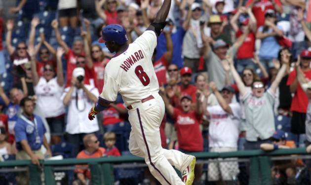 Philadelphia Phillies' Ryan Howard  celebrates after he hit a one run single against the New York Mets in the ninth inning of a baseball game Sunday, Aug. 10, 2014, in Philadelphia. The Phillies won 7-6.  (AP Photo/H. Rumph Jr)