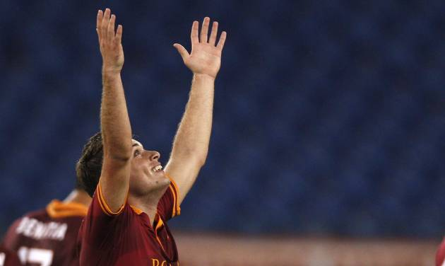 AS Roma forward Adem Ljajic of Serbia celebrates after scoring  during an Italian Serie A soccer match between AS Roma and Livorno at Rome's Olympic stadium, Saturday, Jan. 18, 2014. (AP Photo/Alessandra Tarantino)