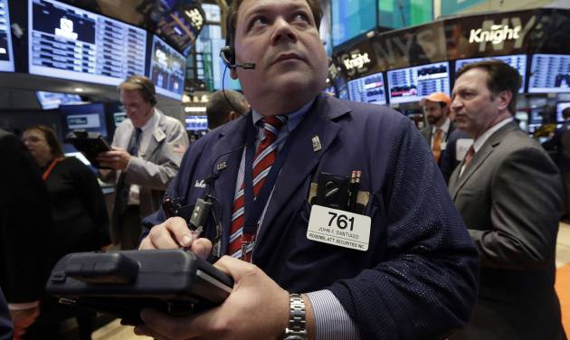 In this Thursday, May 2, 2013, photo, Trader John Santiago works on the floor of the New York Stock Exchange. World stock markets rose Monday May 6, 2013 after an unexpectedly strong U.S. jobs report pushed Wall Street to new highs. Malaysian shares jumped after the country's ruling political alliance won national elections. (AP Photo/Richard Drew)