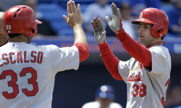 St. Louis Cardinals' Pete Kozma, right, is congratulated by teammate Daniel Descalso after hitting a grand slam during the fourth inning of a spring training baseball game against the New York Mets Tuesday, March 26, 2013, in Port St. Lucie, Fla. (AP Photo/Jeff Roberson) ORG XMIT: FLVR110